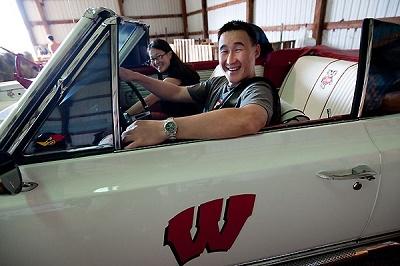 Students driving a car
